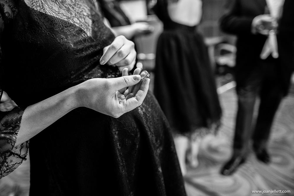 bridesmaid holding engagement ring