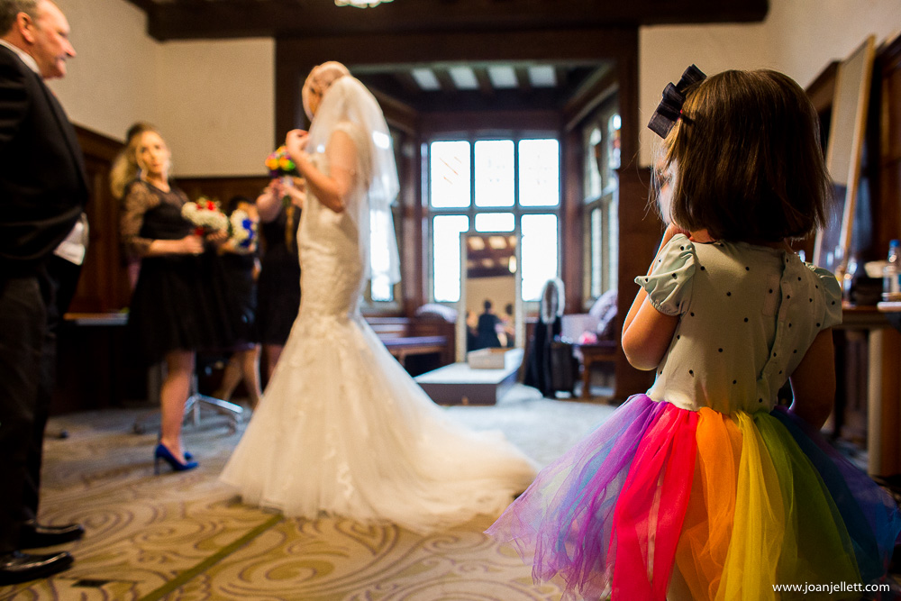 little flower girl looking at the bride