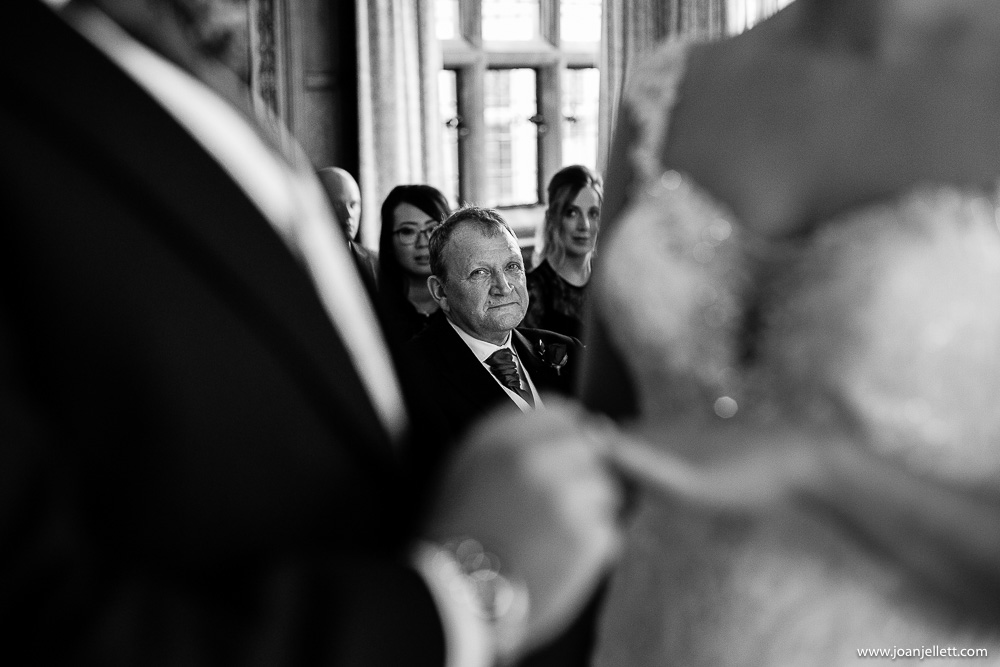 father of the bride during the vows emotional face