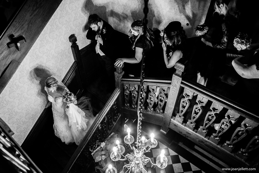 bride walking down the stairs with her groom and guests