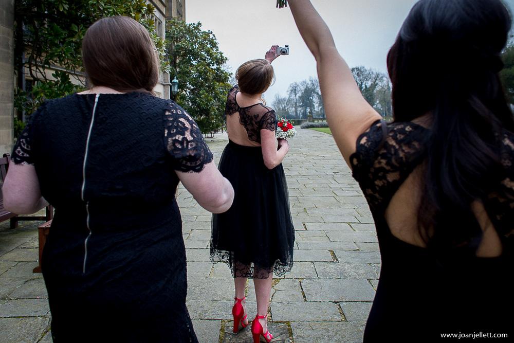 bridesmaid taking pictures