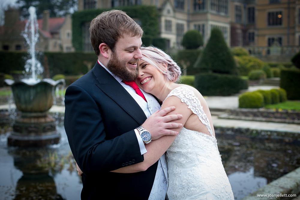 bride and groom cuddling
