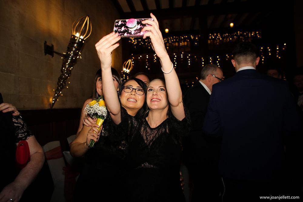 guests taking selfies