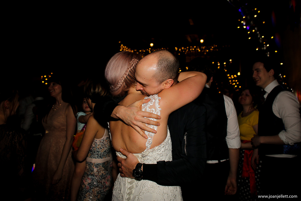 hugging guests and bride