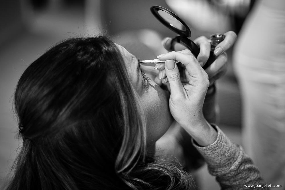 bridesmaid doing her makeup