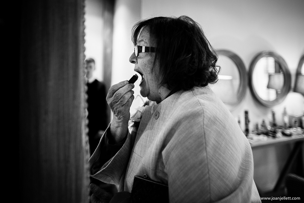 mother of the bride putting on her lipstick