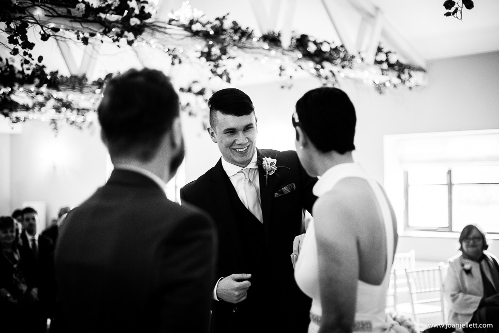son of the bride smiling at his mother