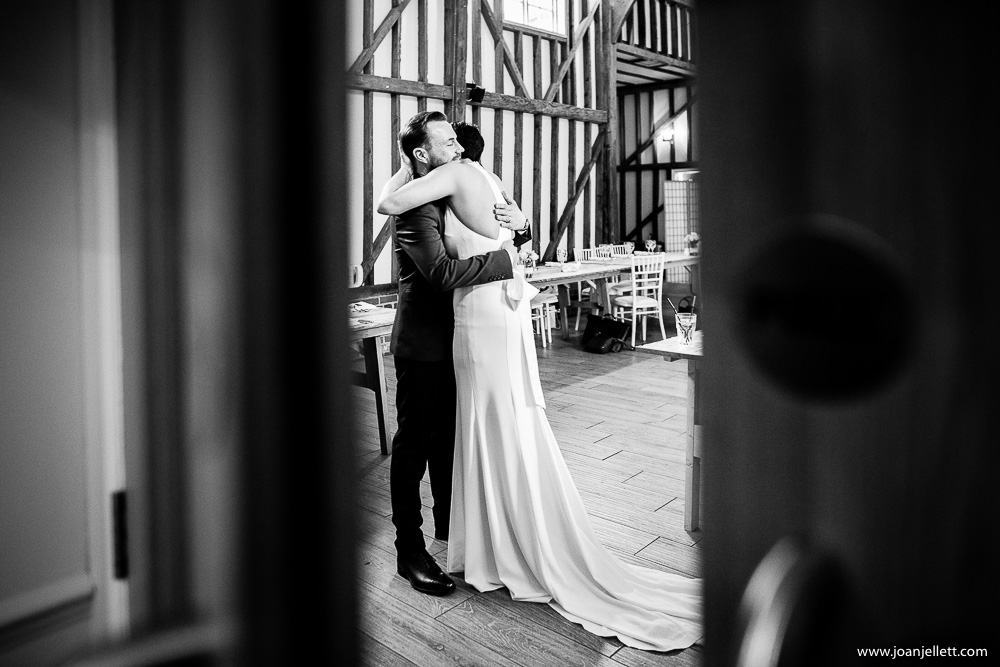 bride and groom hugging in black and white