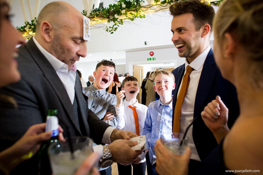 kids laughing at magician