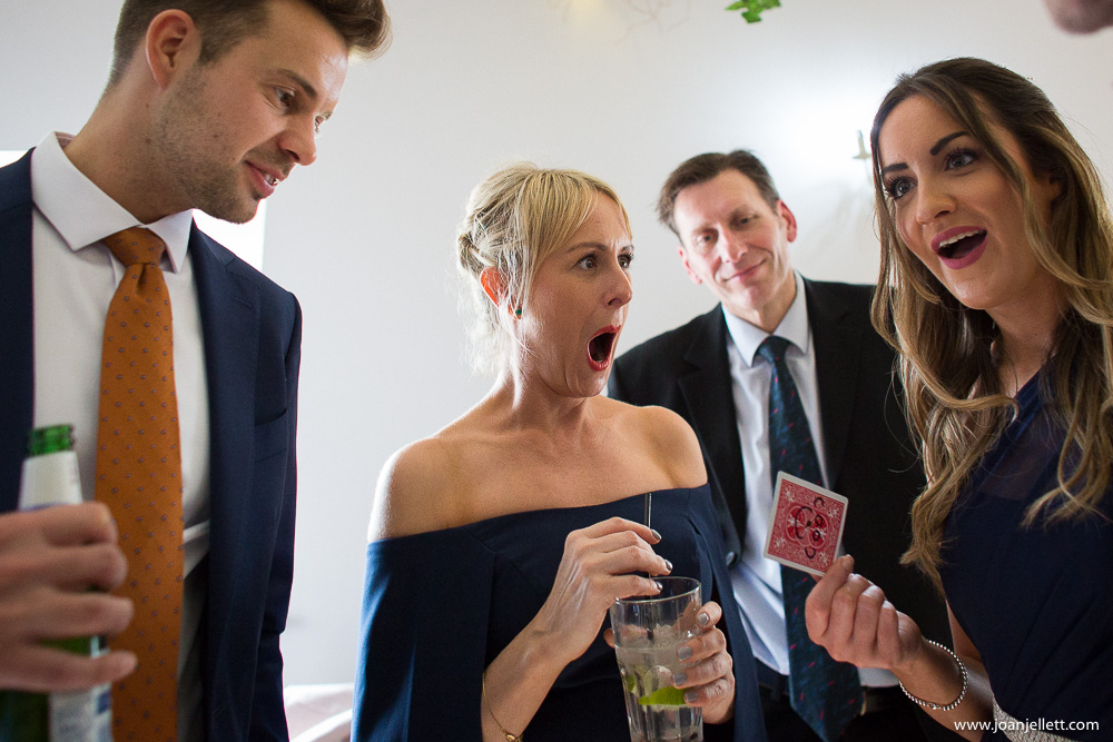 guests being amazed by magician