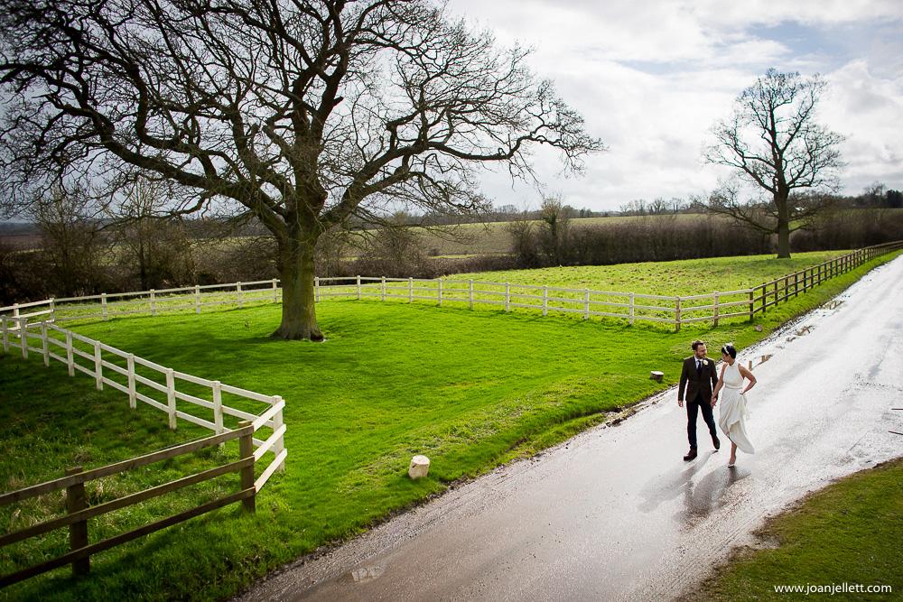 bride and groom walking hand in hand Milling Barn Wedding Photographer