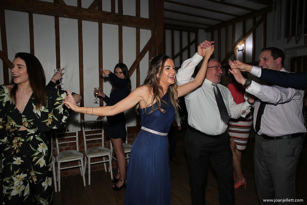Dancing guests in Milling Barn Wedding