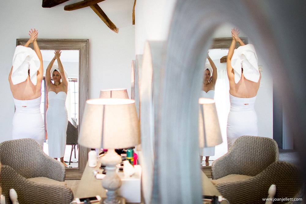 bride hands up looking in the mirror
