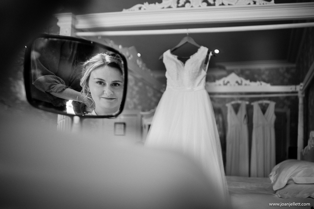 bride looking in the mirror at her dress