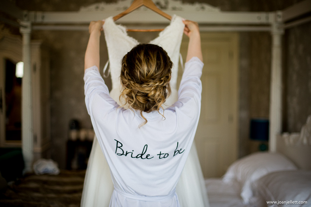 bride getting her dress down