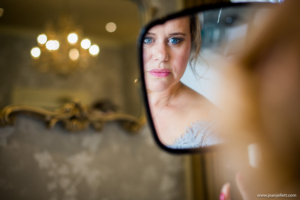 mother of the bride looking in the mirror
