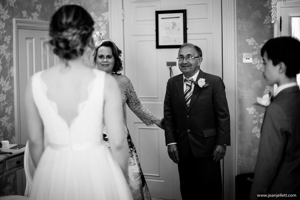father of the bride entering the room