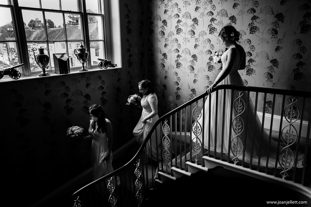 blacka nd white shot of girls going down the stairs