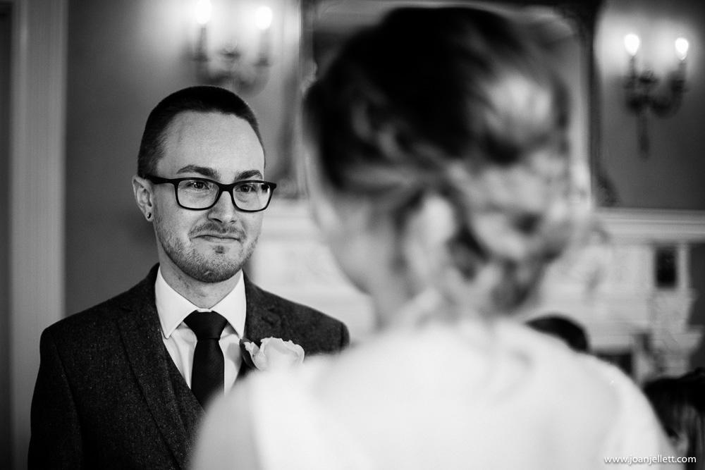 groom looking tenderly at his bride