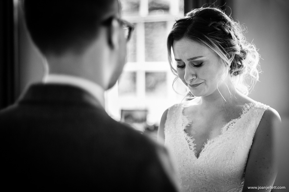bride crying with emotion looking at her groom
