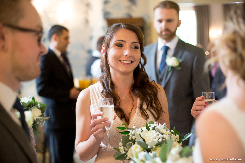 bridesmaid smiling at her best friend