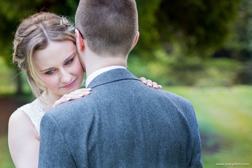 bride hugging her groom