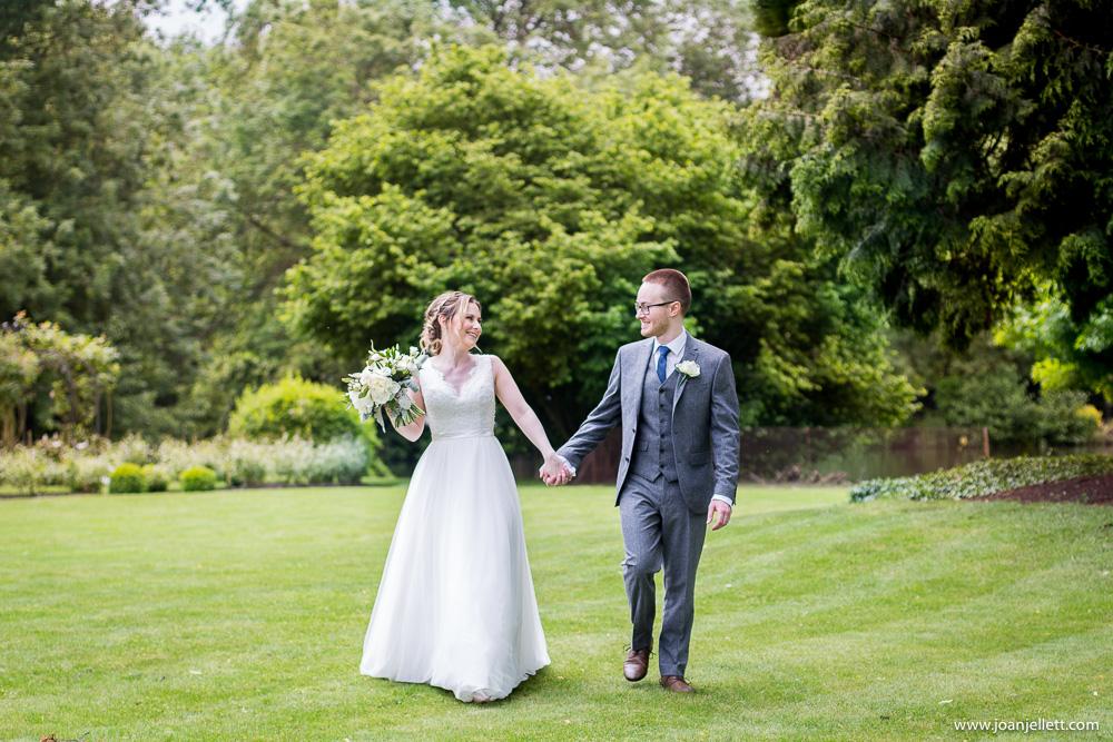 bride and groom walking laughing