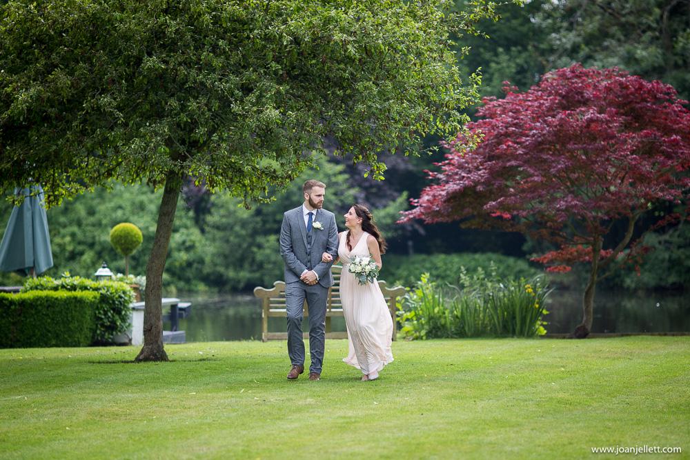 bridesmaid and her boyfriend walking