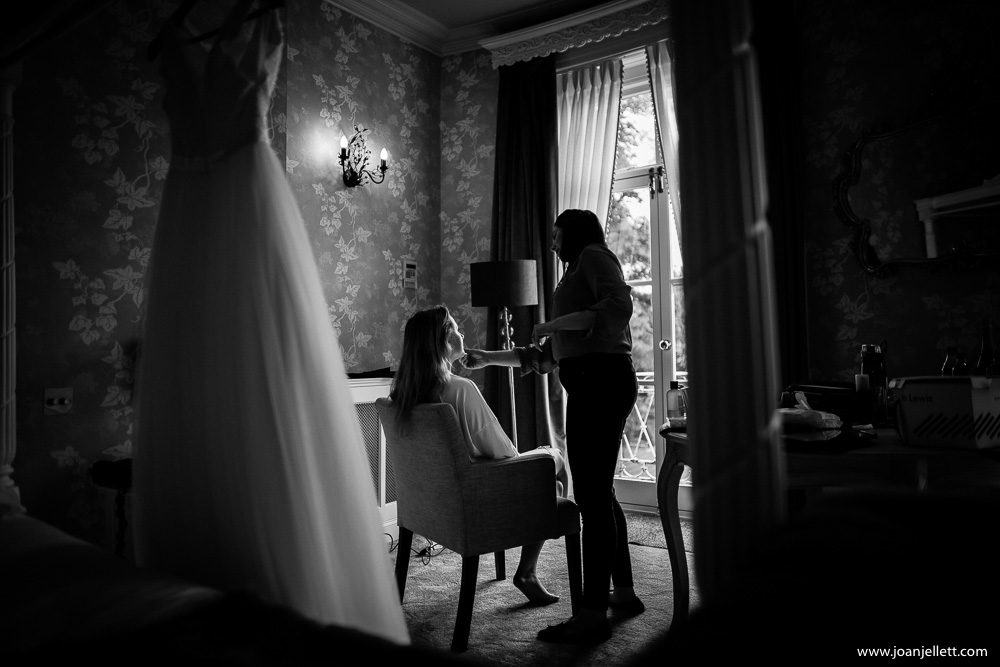 black and white shot of bride during the prep
