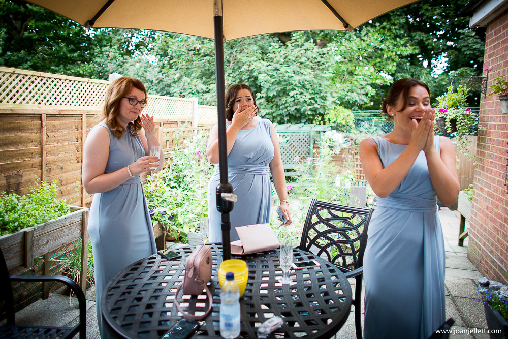 bridesmaids laughing at the bride