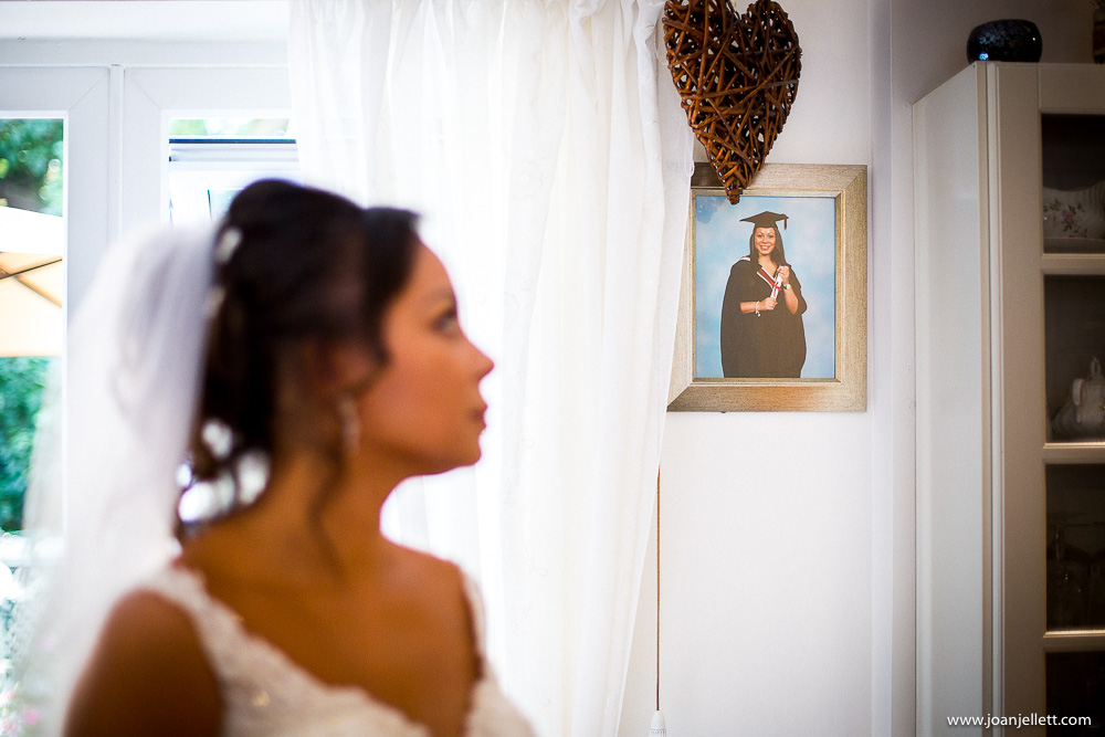 bride looking at a picture of her graduating