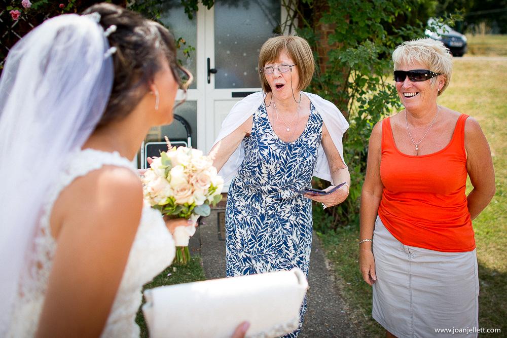 neighbours congratulating bride outside her home