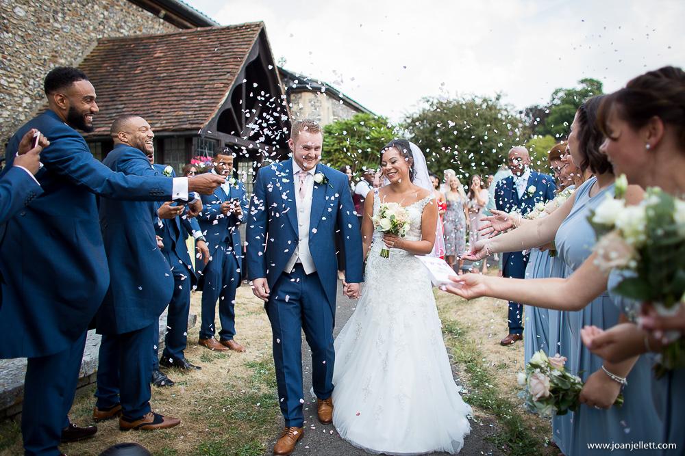 confetti walk of bride and groom