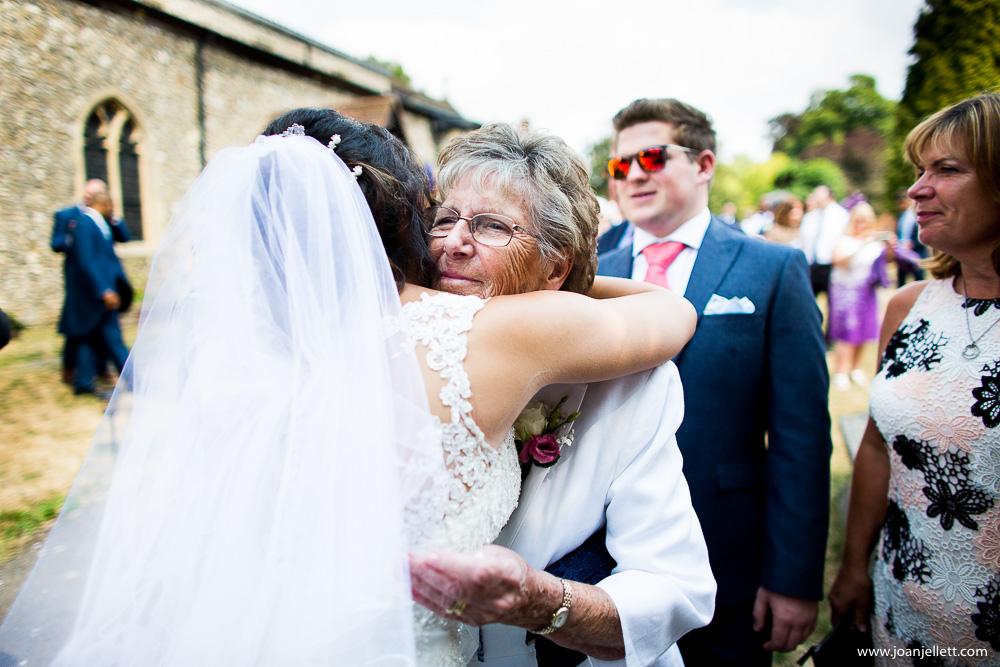 bride hugging her guests