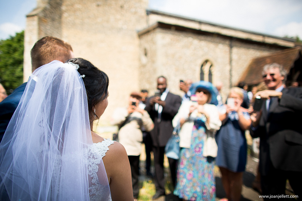 bride and groom looking at their guests