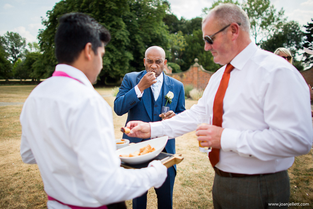 guests eating canapes at Fanhams Hall An Exclusive Venue Wedding Photography