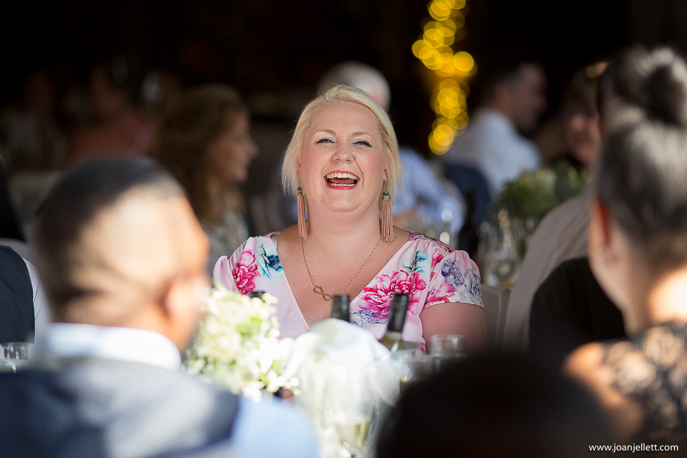 guests laughing out loud during wedding breakfast