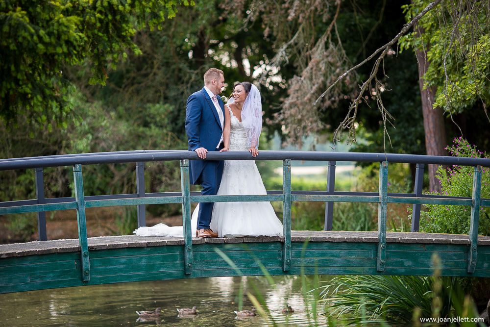 Fanhams Hall An Exclusive Venue Wedding Photography on green bridge