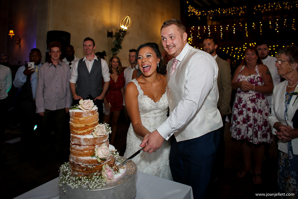 cutting of the cake at Fanhams Hall An Exclusive Venue