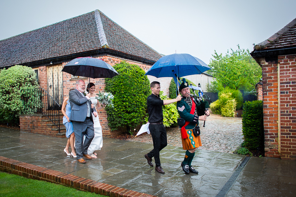 bride walking in the rain at the Coltsfoot