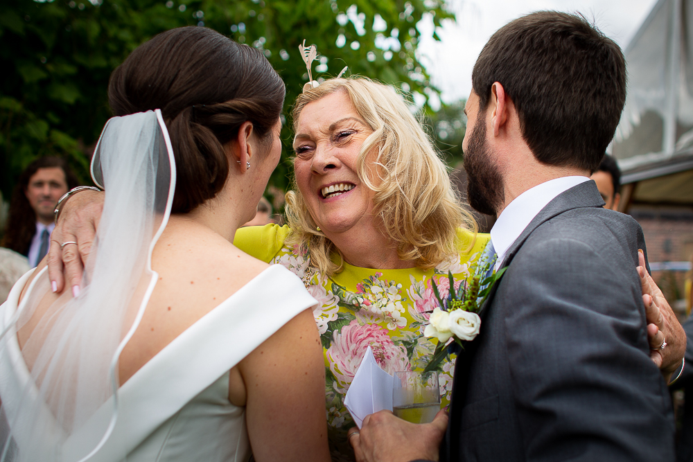 guest greeting the bride and groom