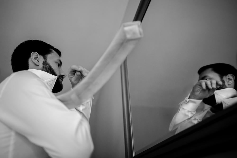 groom putting on his tie