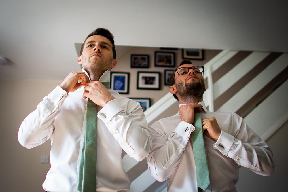 best men doing their tie up