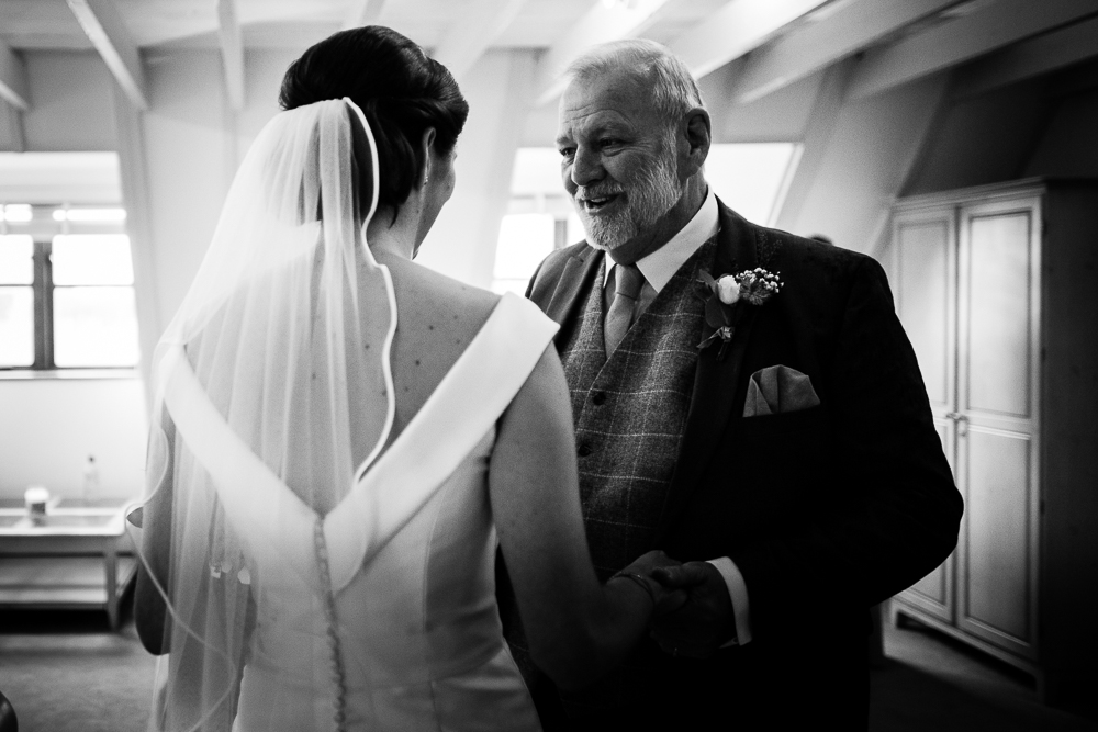 bride and her dad having a moment before walking down the aisle