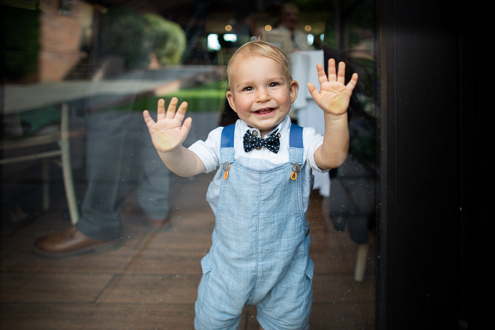 little boy against a glass window at the Coltsfoot