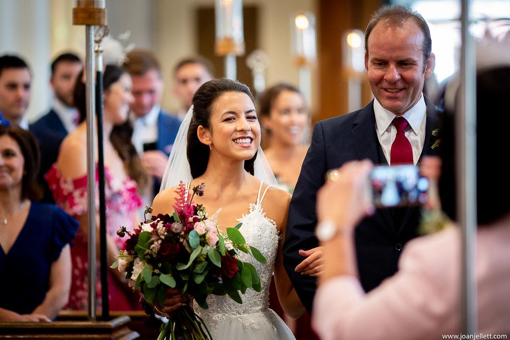 bride smiling at the camera