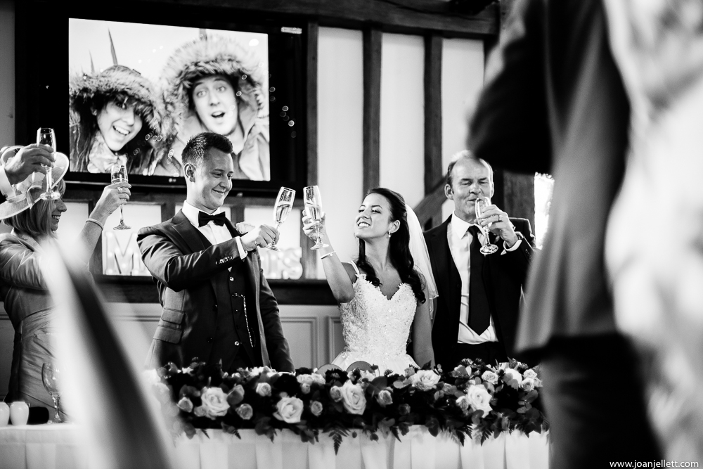 bride and groom giving a cheers