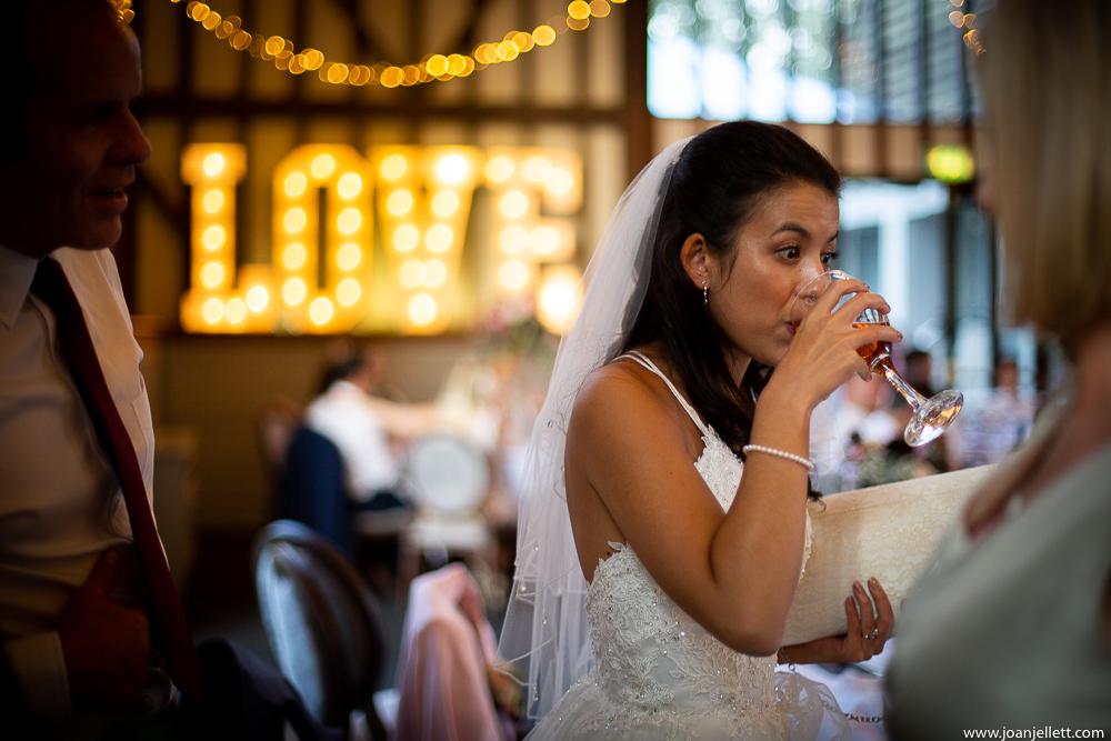 bride drinking rose wine