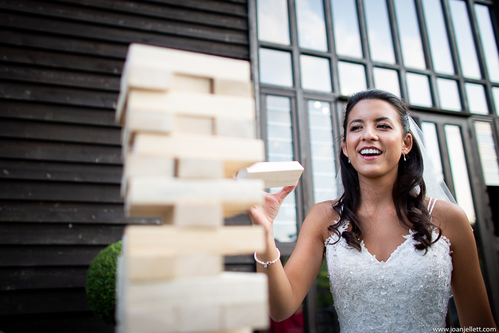 bride having a go at a game of jenga