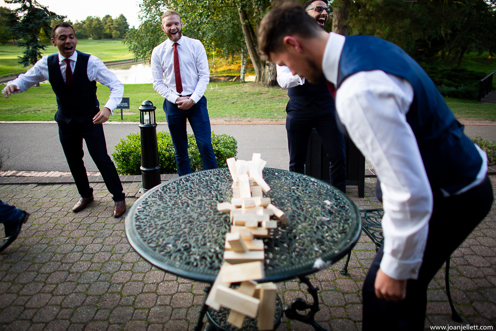 guests destroying a game of jenga